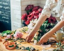 A designer carefully prepares her next arrangement