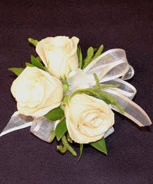 Beautiful three baby roses accented with delicate greens and a ribbon bow.