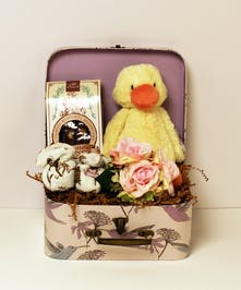 This adorable keepsake set is perfect gift for the bundle of joy and parents.  This gift includes soft hummingbird booties, biscotti, and a silk bouquet nestled with a plush Jellycat duck in a matching keepsake hummingbird suitcase.