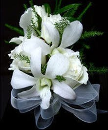 Four baby roses and three dendrobium orchids accented with a touch of green and a ribbon bow