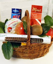 Fruit, cheese, crackers, and chocolates fill this mini gourmet basket. Perfect for any occasion!