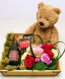 Melt their heart with the Affectionately Yours gift box.  Select a bottle of champagne of your choice,hand-delivered in a wooden gift box with signature Ah Sam roses, two handmade all natural Charles Chocolate bars approximately 3.4 ounces each, and a cuddly plush Jellycat bear!