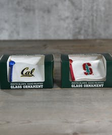 Bears or Trees?  Which rival school will adorn or tree, unless your a divided household.  Hand-blown glass ornaments display the school colors proudly.