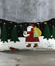 Here comes Santa Clause!  Felt pillow with an applique of Santa walking among the trees.