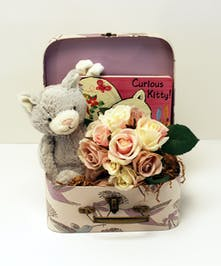 This adorable keepsake gift set includes soft plush Jellycat kitty, companion Curious Kitty book, and a silk bouquet nestled in a matching keepsake hummingbird suitcase.