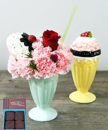 It's always a party with ice cream.  This Ice Cream Treat of carnations and a rose is featured in a ceramic ice cream vase to send well wishes to all.