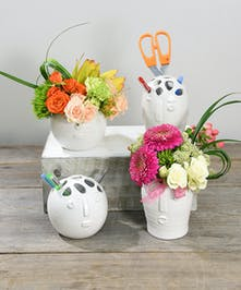 The Blooming Head Bouquet is a contemporary ceramic vase with a fresh attitude. Filled with seasonal blooms. Once the blossoms fade, refill with flowers or perhaps office supplies!