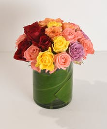 When monochromatic is not an option.  Fancy That...Roses is a custom colorful assortment of 24 premium roses designed in a leaf-lined glass vase.