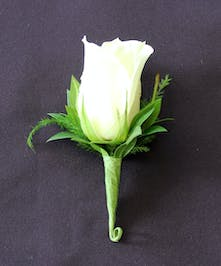 One medium rose boutonniere wrapped with a touch of green foliage..
