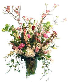 A vase overflowing with, orchids,roses and more...