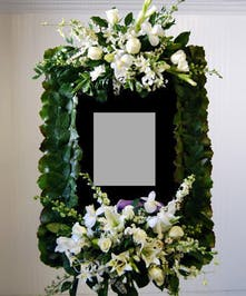 Flowers surround a photo of your loved one.