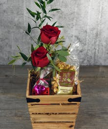 Make this Valentine's sweeter with fresh roses and sweets to someone special. Local Philip Marks dark chocolate raspberry and white chocolate hearts with caramel popcorn presented in a wooden box.