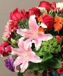 A one of a kind arrangement by our expert designer creating a one of a kind design boasting a mix of seasonal fresh flowers and foliage for your Valentine.