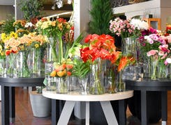 Flowers and vases on display in our storefront